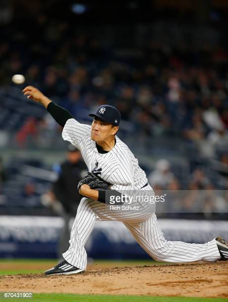 Pitcher Masahiro Tanaka of the New York Yankees delivers a pitch against the Chicago White Sox during the seventh inning of a game at Yankee Stadium...