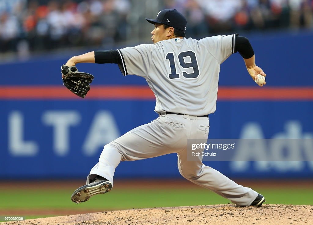 Pitcher Masahiro Tanaka #19 of the New York Yankees delivers a pitch during the third inning of a game against the New York Mets at Citi Field on June 8, 2018 in the Flushing neighborhood of the Queens borough of New York City. The Yankees defeated the Mets 4-1.