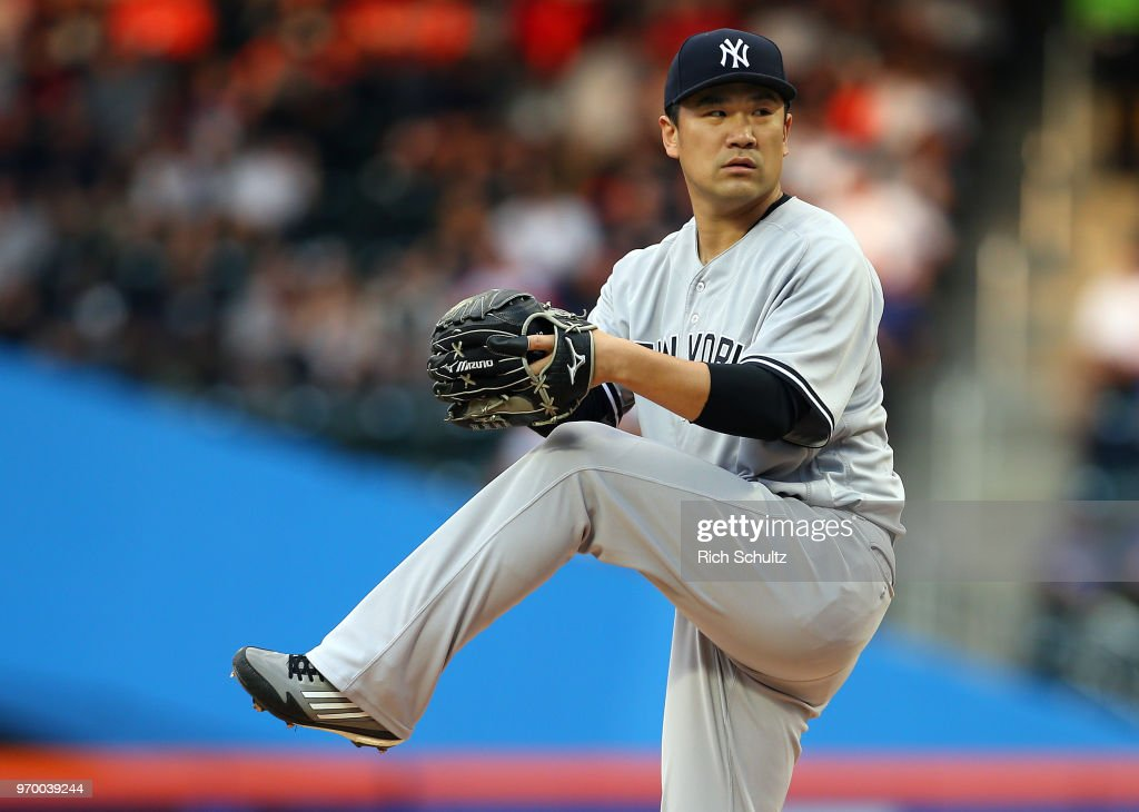 Pitcher Masahiro Tanaka #19 of the New York Yankees delivers a pitch during the first inning of a game against the New York Mets at Citi Field on June 8, 2018 in the Flushing neighborhood of the Queens borough of New York City. The Yankees defeated the Mets 4-1.