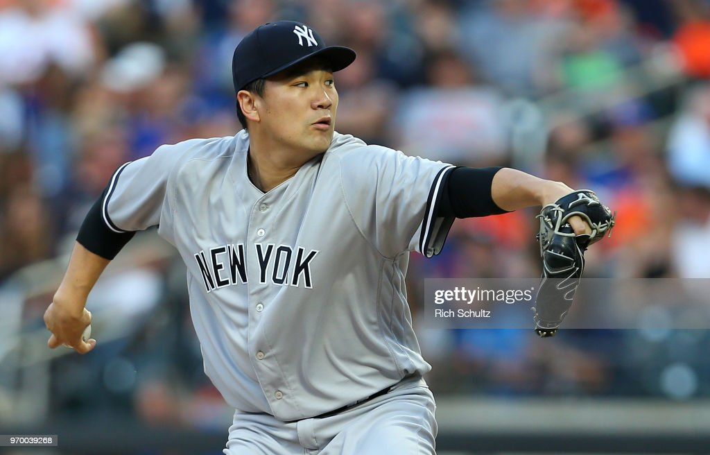 Pitcher Masahiro Tanaka #19 of the New York Yankees delivers a pitch during the second inning of a game against the New York Mets at Citi Field on June 8, 2018 in the Flushing neighborhood of the Queens borough of New York City. The Yankees defeated the Mets 4-1.