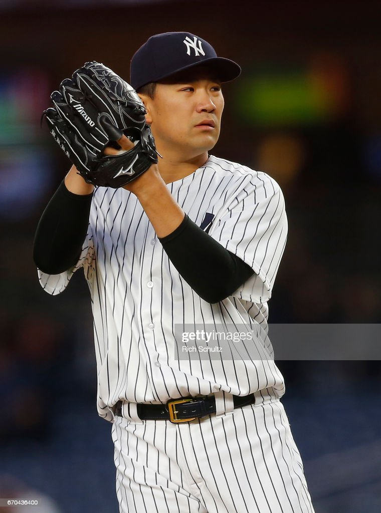 Pitcher Masahiro Tanaka #19 of the New York Yankees gets set to deliver a pitch against the Chicago White Sox during the first inning of a game at Yankee Stadium on April 19, 2017 in New York City. The Yankees defeated the White Sox 9-1.