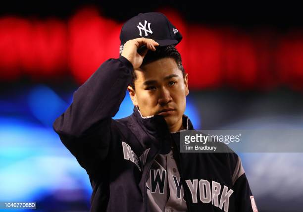 Pitcher Masahiro Tanaka of the New York Yankees looks on before Game Two of the American League Division Series against the Boston Red Sox at Fenway...