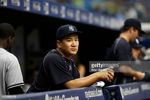 Pitcher Masahiro Tanaka of the New York Yankees looks on from the dugout before the start of a game against the Tampa Bay Rays on April 19 2015 at...