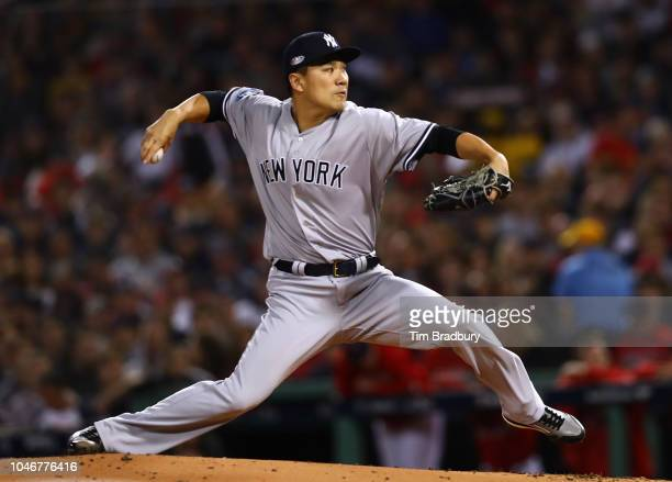 Pitcher Masahiro Tanaka of the New York Yankees pitches during the first inning of Game Two of the American League Division Series against the Boston...