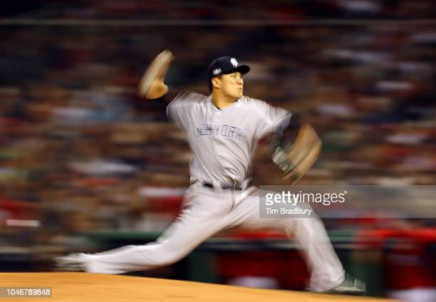 Pitcher Masahiro Tanaka of the New York Yankees pitches during the fourth inning of Game Two of the American League Division Series against the...