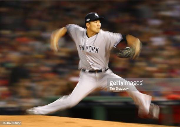 Pitcher Masahiro Tanaka of the New York Yankees pitches during the fifth inning of Game Two of the American League Division Series against the Boston...