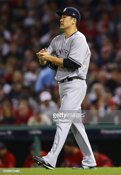 Pitcher Masahiro Tanaka of the New York Yankees pitches during the third inning of Game Two of the American League Division Series against the Boston...