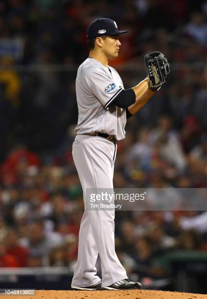 Pitcher Masahiro Tanaka of the New York Yankees pitches during the second inning of Game Two of the American League Division Series against the...