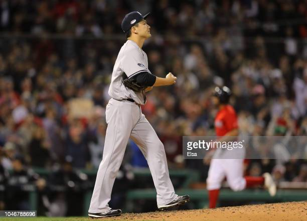 Pitcher Masahiro Tanaka of the New York Yankees reacts as Xander Bogaerts of the Boston Red Sox rounds third base after Bogaerts hit a solo home run...