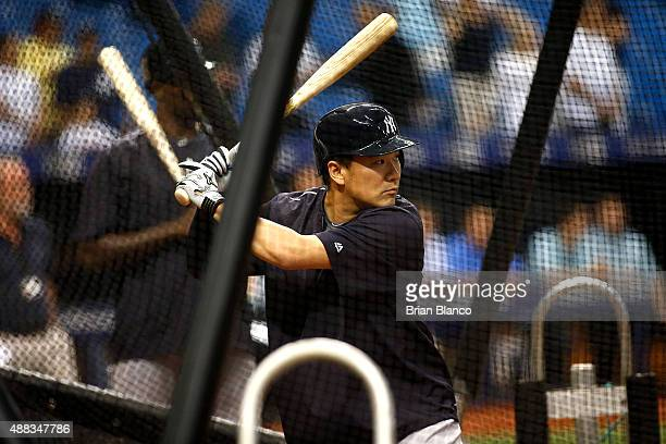 Pitcher Masahiro Tanaka of the New York Yankees takes batting practice before the start of a game against the Tampa Bay Rays on September 15, 2015 at...