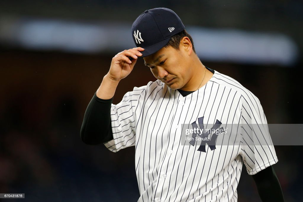 Pitcher Masahiro Tanaka #19 of the New York Yankees takes off his cap after getting out of the fourth inning against the Chicago White Sox during a game at Yankee Stadium on April 19, 2017 in New York City.