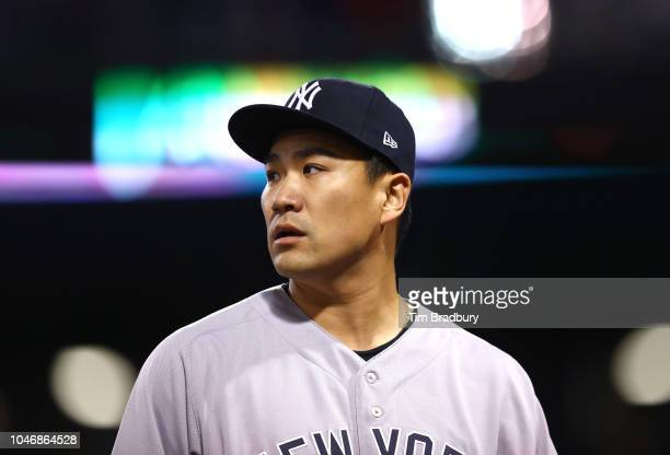 Pitcher Masahiro Tanaka of the New York Yankees walks back to the dugout afterthe first inning of Game Two of the American League Division Series...