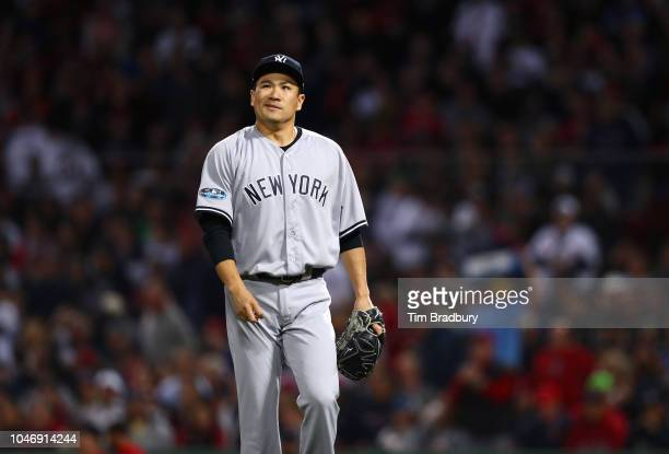 Pitcher Masahiro Tanaka of the New York Yankees walks back to the dugout after the fifth inning of Game Two of the American League Division Series...