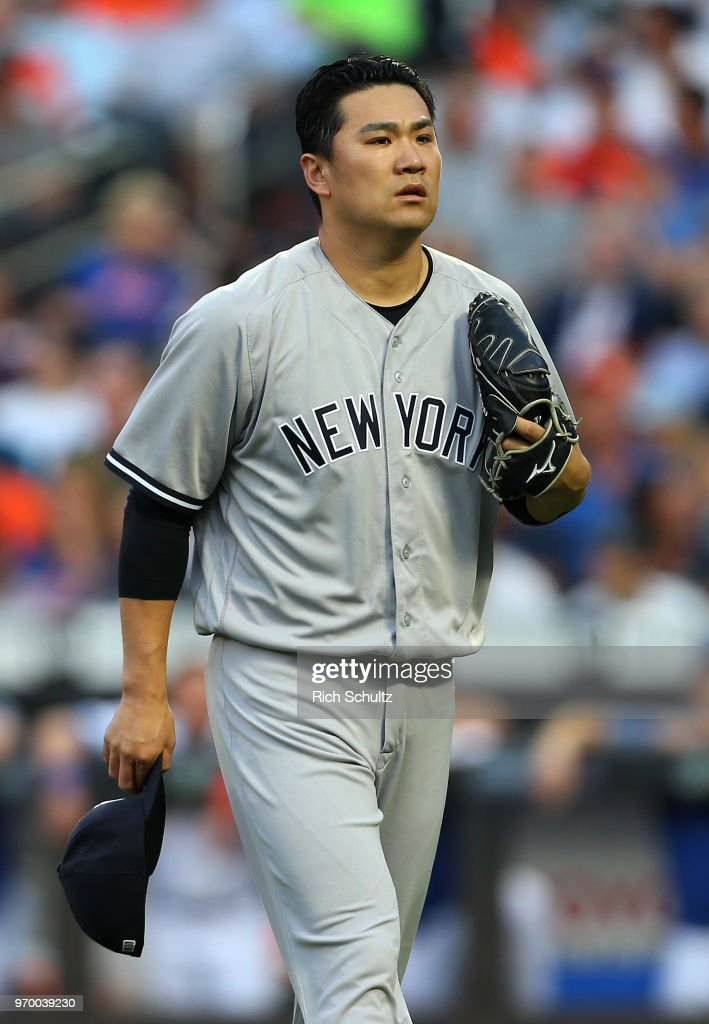 Pitcher Masahiro Tanaka #19 of the New York Yankees walks off the mound after the second inning of a game against the New York Mets at Citi Field on June 8, 2018 in the Flushing neighborhood of the Queens borough of New York City. The Yankees defeated the Mets 4-1.