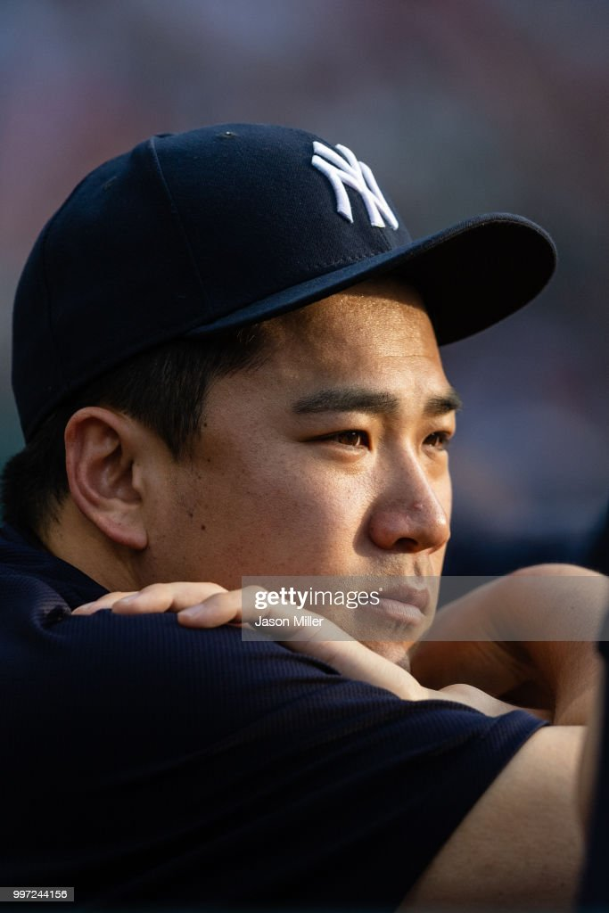Pitcher Masahiro Tanaka #19 of the New York Yankees watches from the dugout during the second inning against the Cleveland Indians at Progressive Field on July 12, 2018 in Cleveland, Ohio.