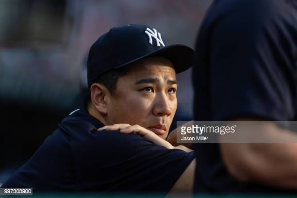 Pitcher Masahiro Tanaka of the New York Yankees watches from the dugout during the second inning against the Cleveland Indians at Progressive Field...