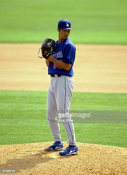 Pitcher Masao Kida of the Los Angeles Dodgers in the stretch during the Spring Training game against the Montreal Expos on March 9 2004 at Space...