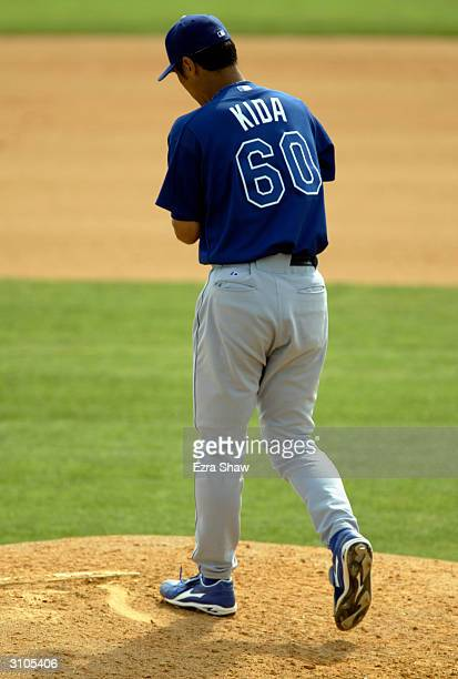 Pitcher Masao Kida of the Los Angeles Dodgers on the mound during the Spring Training game against the Montreal Expos on March 9 2004 at Space Coast...