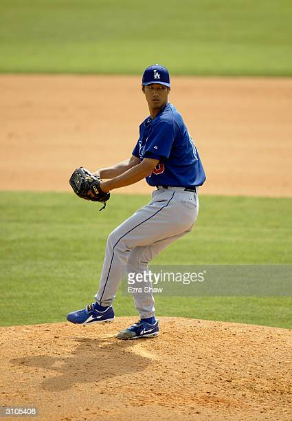 Pitcher Masao Kida of the Los Angeles Dodgers pitches during the Spring Training game against the Montreal Expos on March 9 2004 at Space Coast...