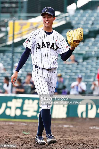 Pitcher Masato Morishita of Japan celebrates after winning in the super round game between Japan v Cuba during the 2015 WBSC U-18 Baseball World Cup...