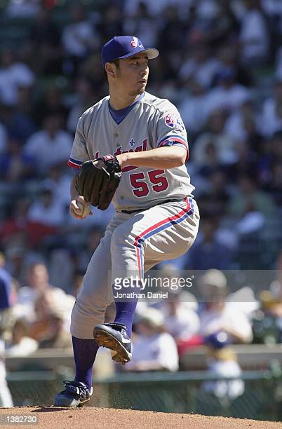 Pitcher Masato Yoshii of the Montreal Expos delivers the ball in the first inning against the Chicago Cubs during a game on September 11 2002 at...
