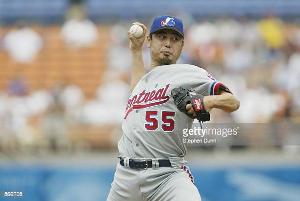 Pitcher Masato Yoshii of the Montreal Expos throws a pitch during the MLB game against the Los Angeles Dodgers at Dodger Stadium in Los Angeles...