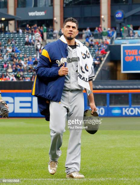 Pitcher Matt Garza of the Milwaukee Brewers walks in from the bullpen before pitching in an MLB baseball game against the New York Mets on May 29...