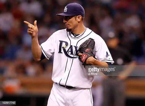 Pitcher Matt Garza of the Tampa Bay Rays acknowledges outfielder Carl Crawford for his catch in the second inning against the Boston Red Sox during...
