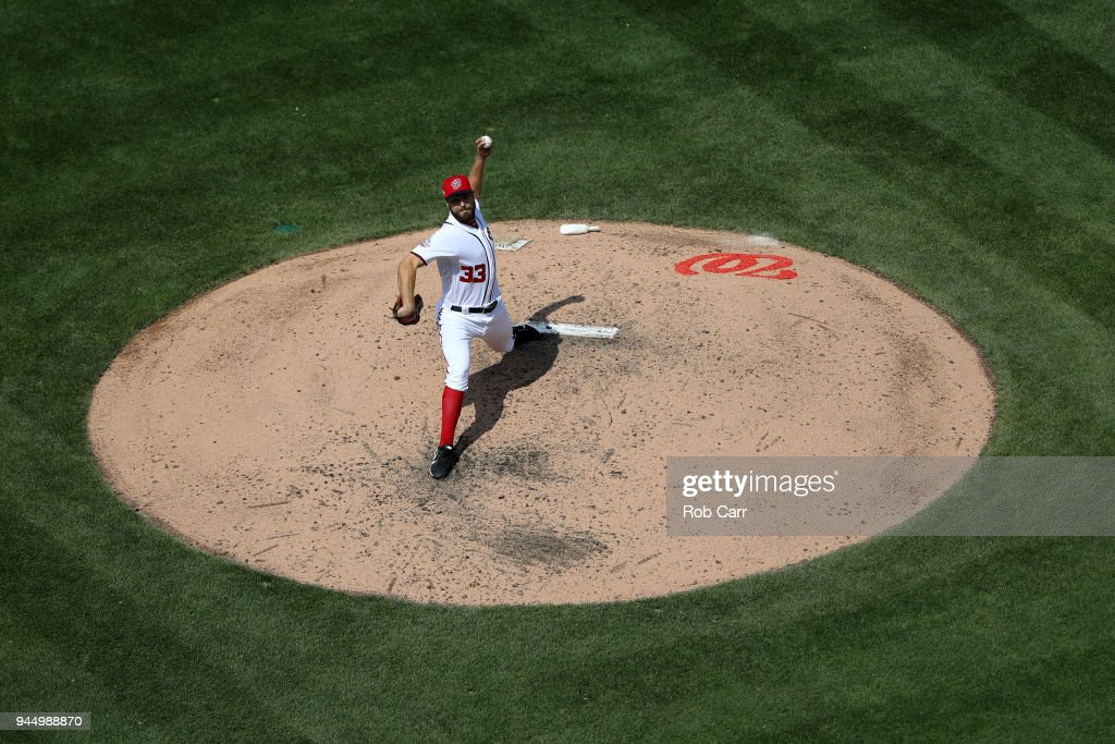 Pitcher Matt Grace #33 of the Washington Nationals throws to an Atlanta Braves batter at Nationals Park on April 11, 2018 in Washington, DC.
