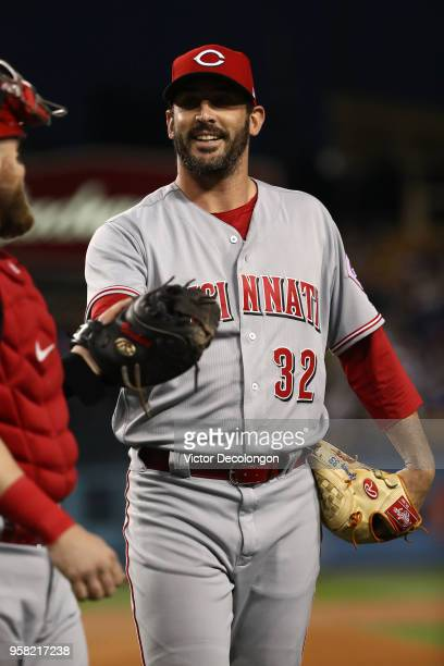 Pitcher Matt Harvey and catcher Tucker Barnhart of the Cincinnati Reds share a word as they enter the dugout after the second inning of the MLB game...