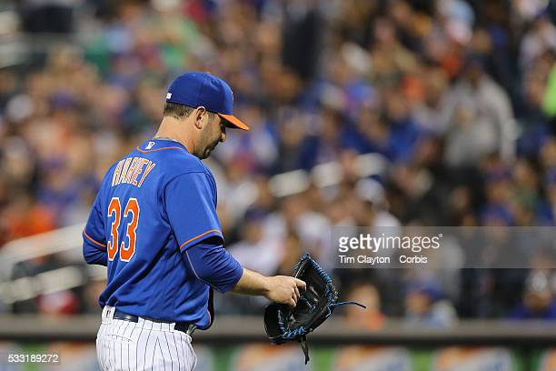 Pitcher Matt Harvey of the New York Mets walks back to the dugout after being pulled from the game in the third inning during the Washington...
