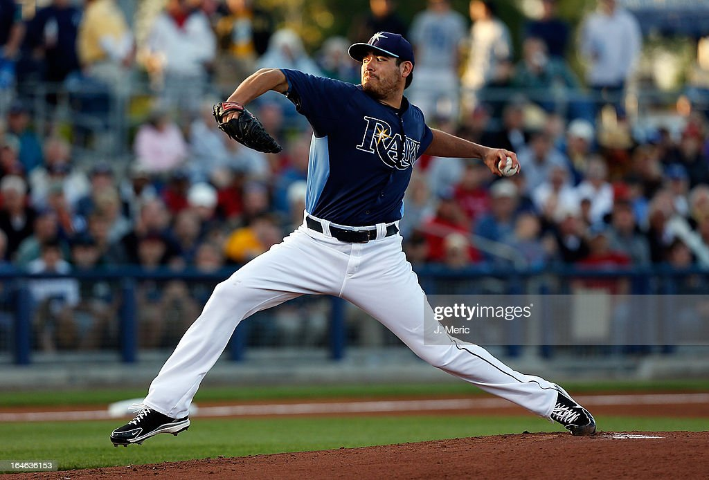 Pitcher Matt Moore #55 of the Tampa Bay Rays pitches against the Pittsburgh Pirates during a Grapefruit League Spring Training Game at the Charlotte Sports Complex on March 25, 2013 in Port Charlotte, Florida.
