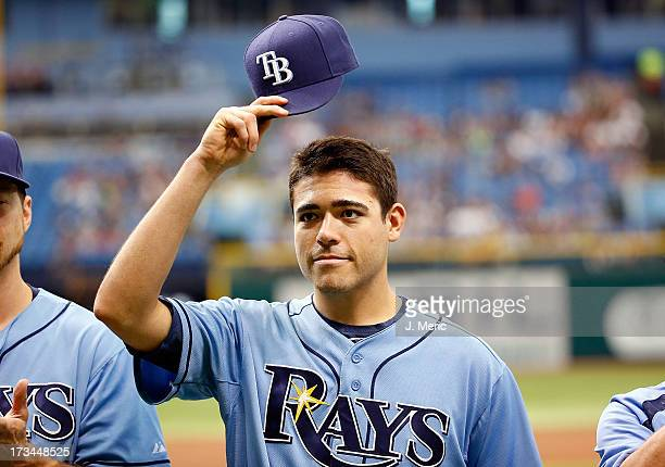 Pitcher Matt Moore of the Tampa Bay Rays tips his hat as he receives his all star jersey just before the start of the game against the Houston Astros...