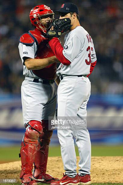 Pitcher Matt Morris of the St Louis Cardinals consults with catcher Mike Matheny during game five of the National League Championship Series against...