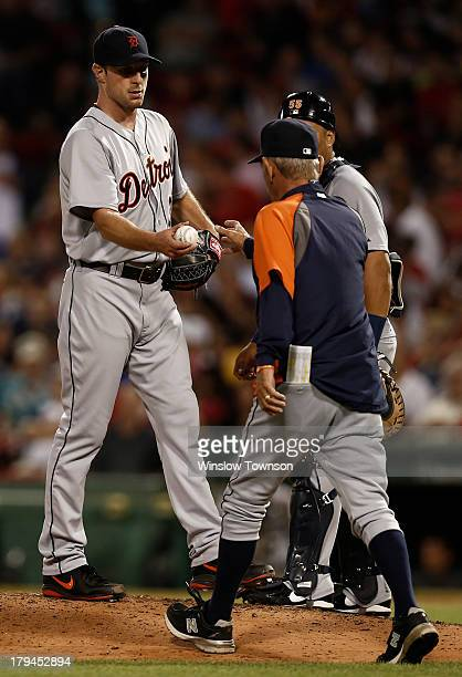 Pitcher Max Scherzer hands the ball to manager Jim Leyland of the Detroit Tigers during the ninth inning of their 21 loss to the Boston Red Sox at...