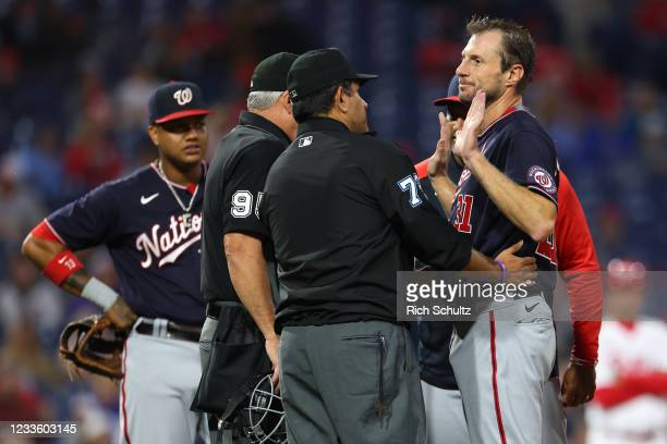 Pitcher Max Scherzer of the Washington Nationals is searched for foreign substances by umpires Tim Timmons and Alfonso Marquez during the fourth...