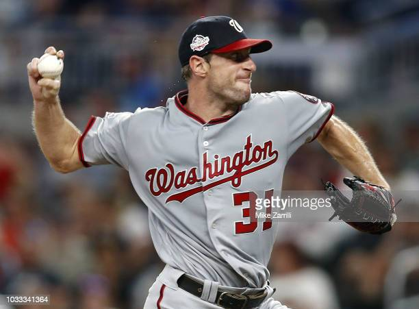 Pitcher Max Scherzer of the Washington Nationals throws a pitch in the second inning during the game against the Atlanta Braves at SunTrust Park on...