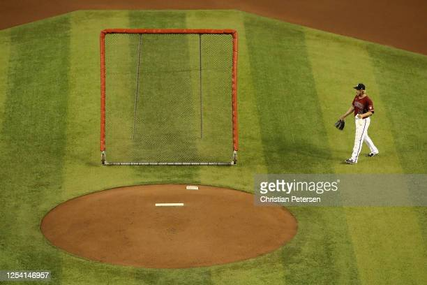 Pitcher Merrill Kelly of the Arizona Diamondbacks walks to the mound as he participates in summer workouts ahead of the abbreviated MLB season at...