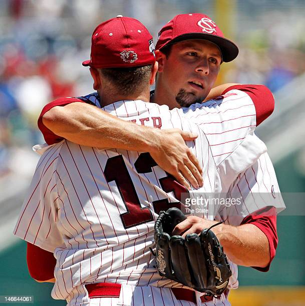 Pitcher Michael Roth right of South Carolina is congratulated by Christian Walker after a 41 win over Kent State in the College World Series on June...