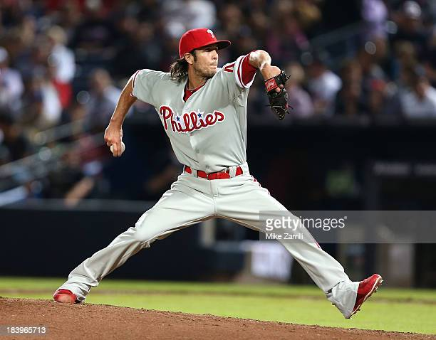 Pitcher Michael Stutes of the Philadelphia Phillies throws a pitch during the game against the Atlanta Braves at Turner Field on September 28 2013 in...
