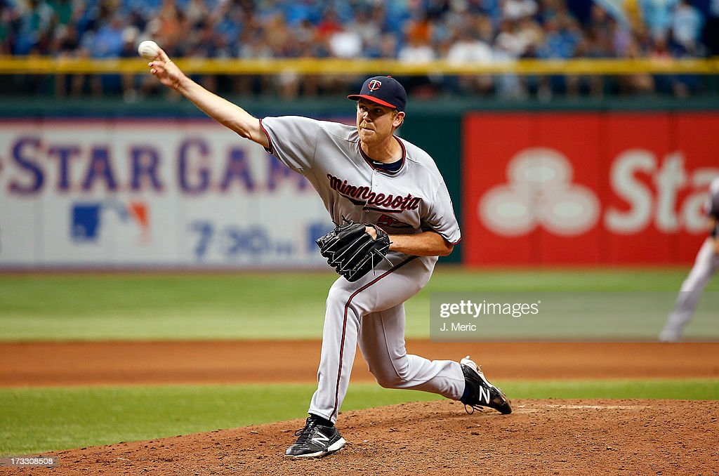 Pitcher Michael Tonkin #72 of the Minnesota Twins pitches in the eighth inning against the Tampa Bay Rays during the game at Tropicana Field on July 11, 2013 in St. Petersburg, Florida.