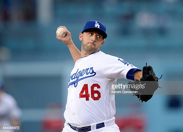Pitcher Mike Bolsinger of the Los Angeles Dodgers throws against the Cincinnati Reds during the first inning of the baseball game at Dodger Stadium...