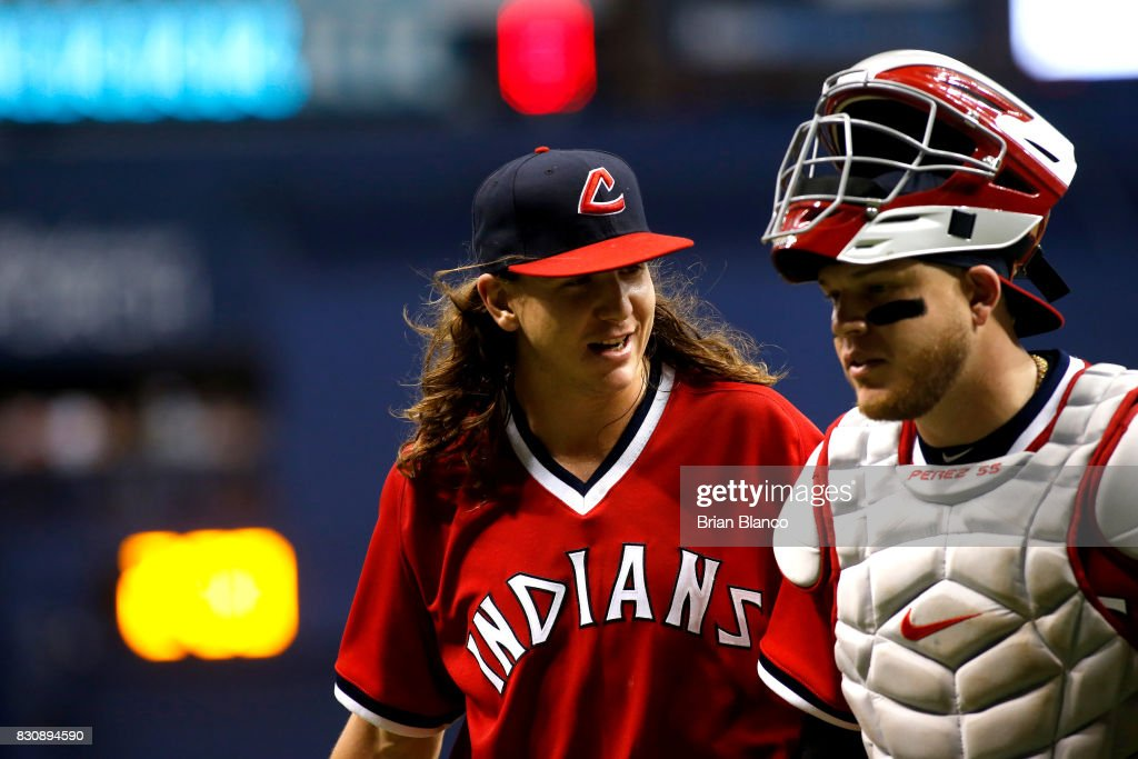 Pitcher Mike Clevinger #52 of the Cleveland Indians speaks with catcher Roberto Perez #55 as they make their way to the dugout following the fifth inning of a game against the Tampa Bay Rays on August 12, 2017 at Tropicana Field in St. Petersburg, Florida.