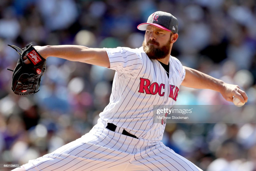Pitcher Mike Dunn #38 of the Colorado Rockies throws in the sixth inning against the Los Angeles Dodgers at Coors Field on May 14, 2017 in Denver, Colorado. Members of both teams were wearing pink in commemoration of Mother's Day weekend.