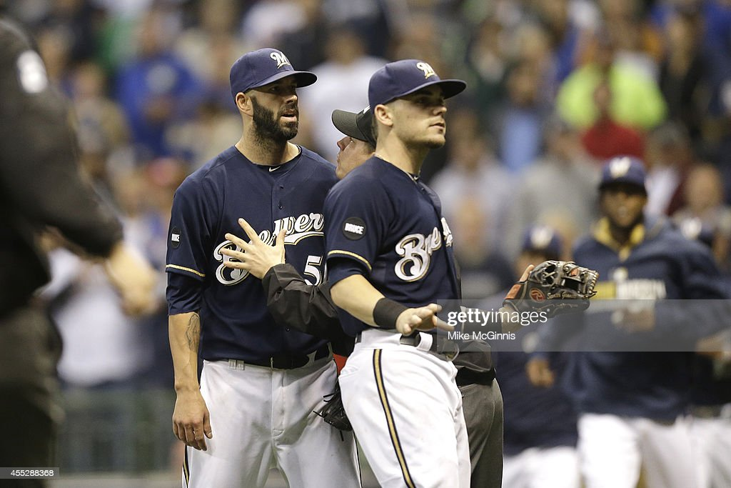 Pitcher Mike Fiers #50 of the Milwaukee Brewers looks to the Miami Marlins dugout after nearly hitting Reed Johnson during the bottom of the fifth inning at Miller Park on September 11, 2014 in Milwaukee, Wisconsin.