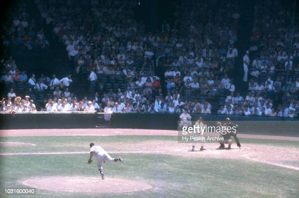 Pitcher Mike Garcia of the Cleveland Indians throws the ball as Charlie Maxwell of the Detroit Tigers swings during an MLB game on July 5 1959 at...