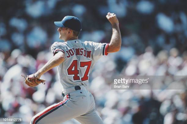 Pitcher Mike Johnson of the Montreal Expos throws a pitch against the Colorado Rockies during their Major League Baseball National League West game...