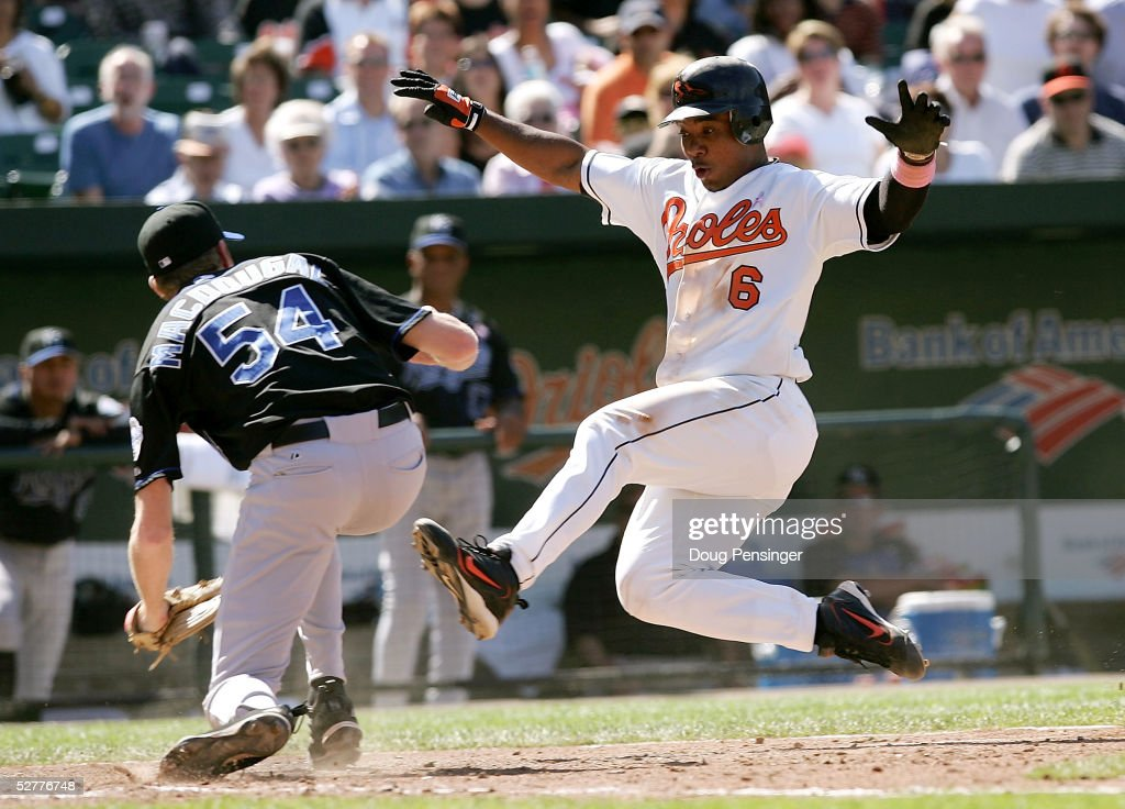 Pitcher Mike MacDougal #54 of the Kansas City Royals prepares to tag out Melvin Mora #6 of the Baltimore Orioles at home plate to end a 7 run 6th inning by the Orioles on May 8, 2005 at Oriole Park at Camden Yards in Baltimore, Maryland.