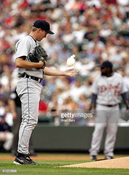 Pitcher Mike Maroth of the Detroit Tigers tosses the chalk bag before starting the game against the Colorado Rockies on July 3, 2004 at Coors Field...