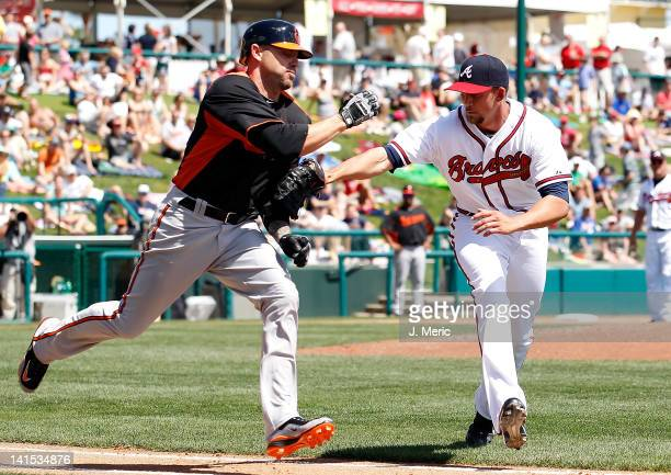 Pitcher Mike Minor of the Atlanta Braves applies the tag to outfielder Scott Beerer of the Baltimore Orioles after a bunt attempt during a Grapefruit...